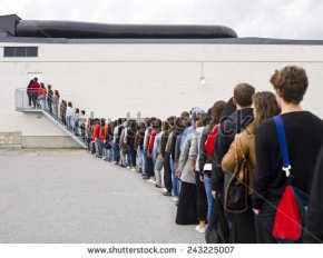 stock-photo-large-group-of-people-waiting-in-line-243225007